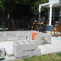 Photo Thumbnail #2: After the first two courses of concrete block...