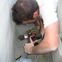 Photo Thumbnail #4: Drilling the hole for the electrical outlet for...