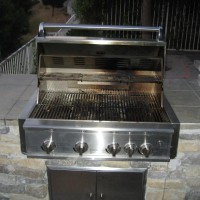 Photo Thumbnail #11: 4 burner w/ rotisserie stainless steel grill.