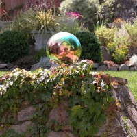 Photo Thumbnail #12: A gazing ball on top of an old outdoor...