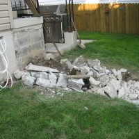Photo Thumbnail #8: Breaking up the old porch.