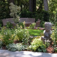 Photo Thumbnail #1: Bust is in planting bed that surrounds main...