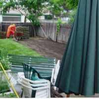 Photo Thumbnail #1: Nothing like a raining day to lay some sod.....