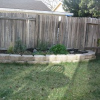 Photo Thumbnail #3: The herb garden looks a little sparse in the...
