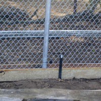 Photo Thumbnail #7: closeup of forms. fence will be buried in concrete