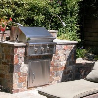 Photo Thumbnail #1: Outdoor kitchen features gas grill, flexible...