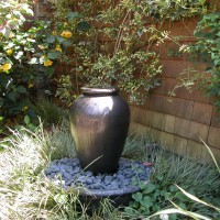 Photo Thumbnail #3: Water feature is an urn where water slowly...