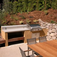 Photo Thumbnail #4: Another view of outdoor kitchen.  Table is...