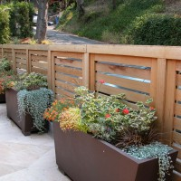 Photo Thumbnail #12: Metal planters with colorful plantings....