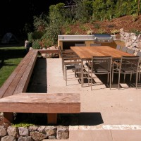Photo Thumbnail #2: Teak bench surrounds stabilized decomposed...