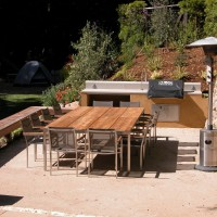 Photo Thumbnail #7: Outdoor kitchen and dining area.