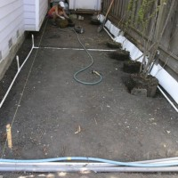 Photo Thumbnail #3: The excavated side yard, with irrigation and...