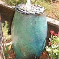 Photo Thumbnail #9: Fountain from a ceramic pot. I dug a hole below...