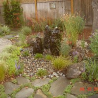 Photo Thumbnail #13: Pondless water feature consists of cored stone...
