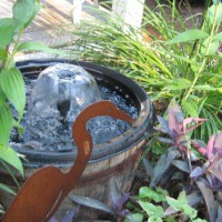 Photo Thumbnail #5: Small pond feature. Side yard near porch.