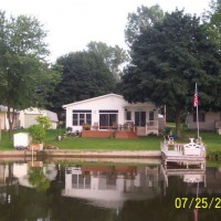 Photo Thumbnail #23: a shot of the house from the lake