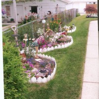 Photo Thumbnail #17: Pond became this 3 part flower bed on the south...