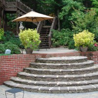 Photo Thumbnail #12: stone steps lead to a patio and stairs to upper...