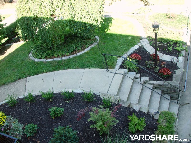 Landscaping ideas front yard slippery slope solution for Sloped yard solutions