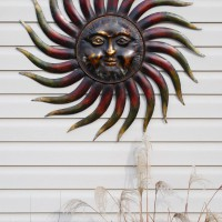 Photo Thumbnail #6: New metal sun for the big blank wall of siding...