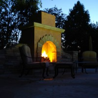 Photo Thumbnail #4: outdoor fireplace near pool area.