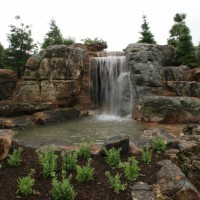 Photo Thumbnail #2: The main waterfalls and the rocky berm made to...