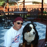 Photo Thumbnail #1:  In the backyard on the deck with my dog Cleo.