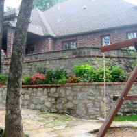 Photo Thumbnail #5: New stone retaining walls replace the original...