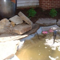 Photo Thumbnail #1: Our new pond! Fountain in the works:) Love the...