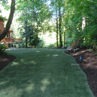 Photo Thumbnail #1: Backyard back end after artificial turf install
