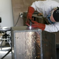 Photo Thumbnail #9: Plasma cutting the smoke hole.