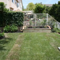 Photo Thumbnail #3: The finished product!  New sod, planter, and...