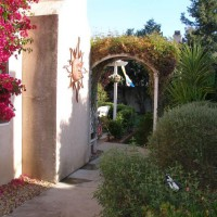 Photo Thumbnail #2: Side yard include a trellis and bouganvillea,...