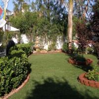Photo Thumbnail #4: Landcaped backyard includes raised plantar...