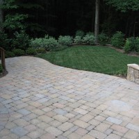Photo Thumbnail #5: Patio made of tumbled cobblestone-style pavers....