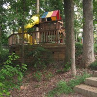 Photo Thumbnail #6: Timber retaining wall tucked into woods creates...