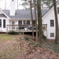 Photo Thumbnail #1: The backyard before.  Yard sloped off into...