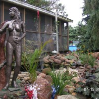 Photo Thumbnail #14: The pond area is under the watchful eye of Eve.