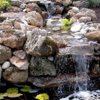 Photo Thumbnail #1: Small series of waterfalls and small pond