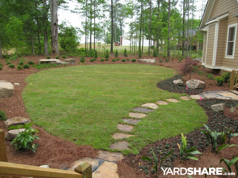 Landscaping ideas endless possibilities the wood duck for Above ground pool removal ideas