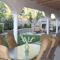 Photo Thumbnail #1: The yard- solid patio cover with fans, dining,...