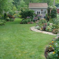 Photo Thumbnail #1: view of backyard from house. Yard is divided,...