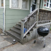 Photo Thumbnail #1: Side patio leading to backyard and garage