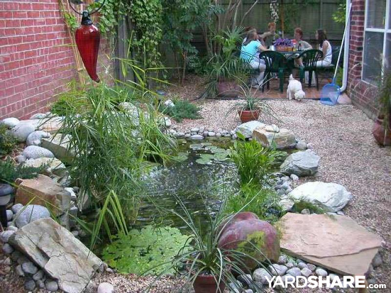 Landscaping ideas super small yard now has an in ground for Small raised pond ideas
