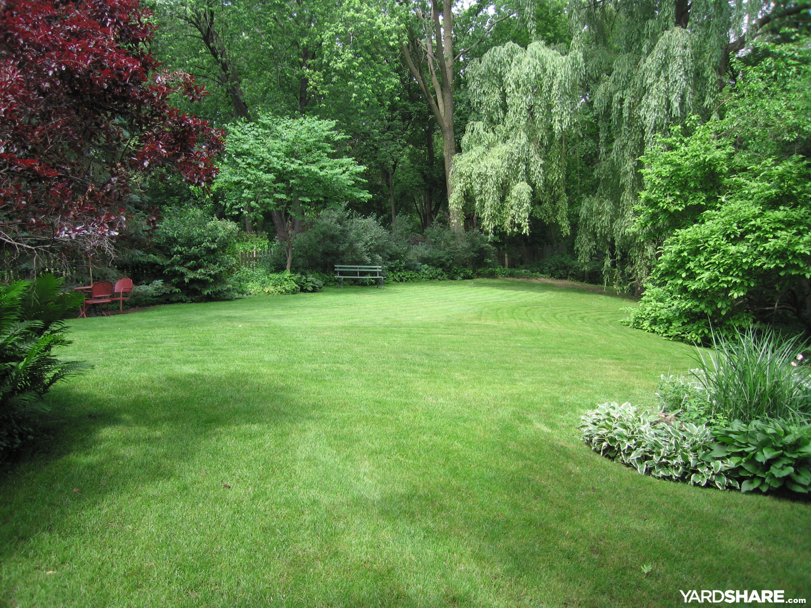 Landscaping ideas backyard at whispering oaks for Backyard garden