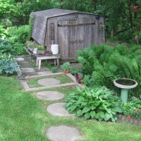 Photo Thumbnail #5: The circular stones lead to our vintage shed...