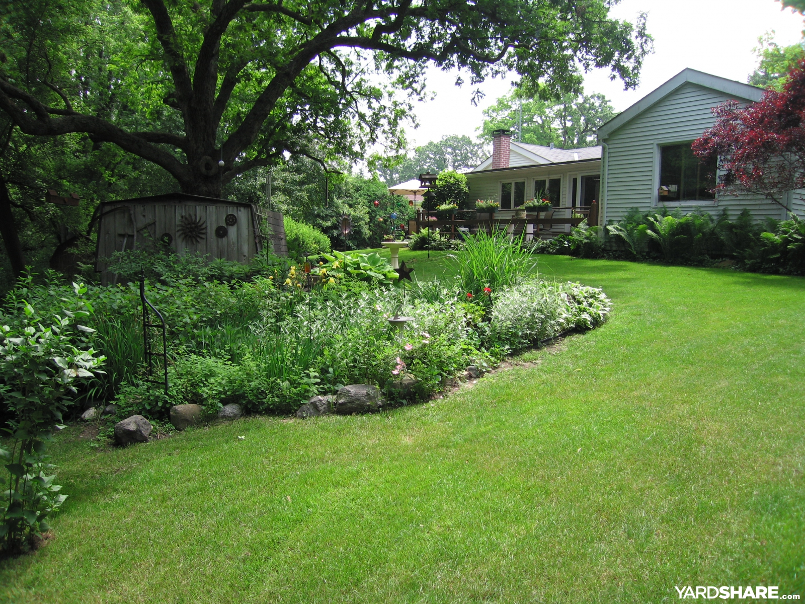 Landscaping ideas backyard at whispering oaks for Pics of landscaped backyards