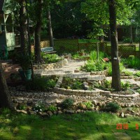 Photo Thumbnail #1: Creek and shade garden, with the water running...
