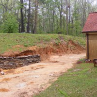 Photo Thumbnail #1: Starting the rock retaining wall