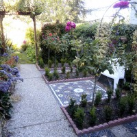 Photo Thumbnail #4: Side rose garden with trellis and pebble mosaic...
